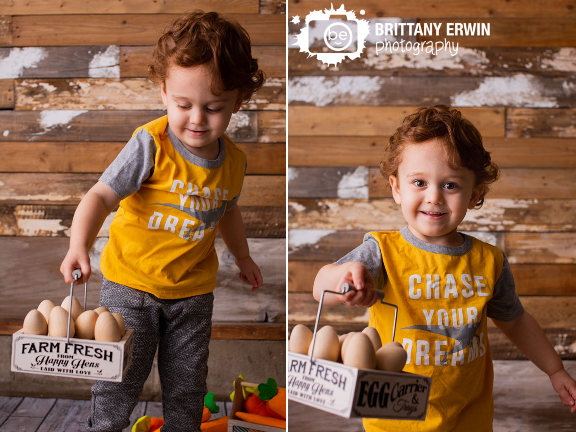 Indianapolis-easter-spring-mini-session-photographer-toddler-boy-carrying-egg-carton-tray.jpg