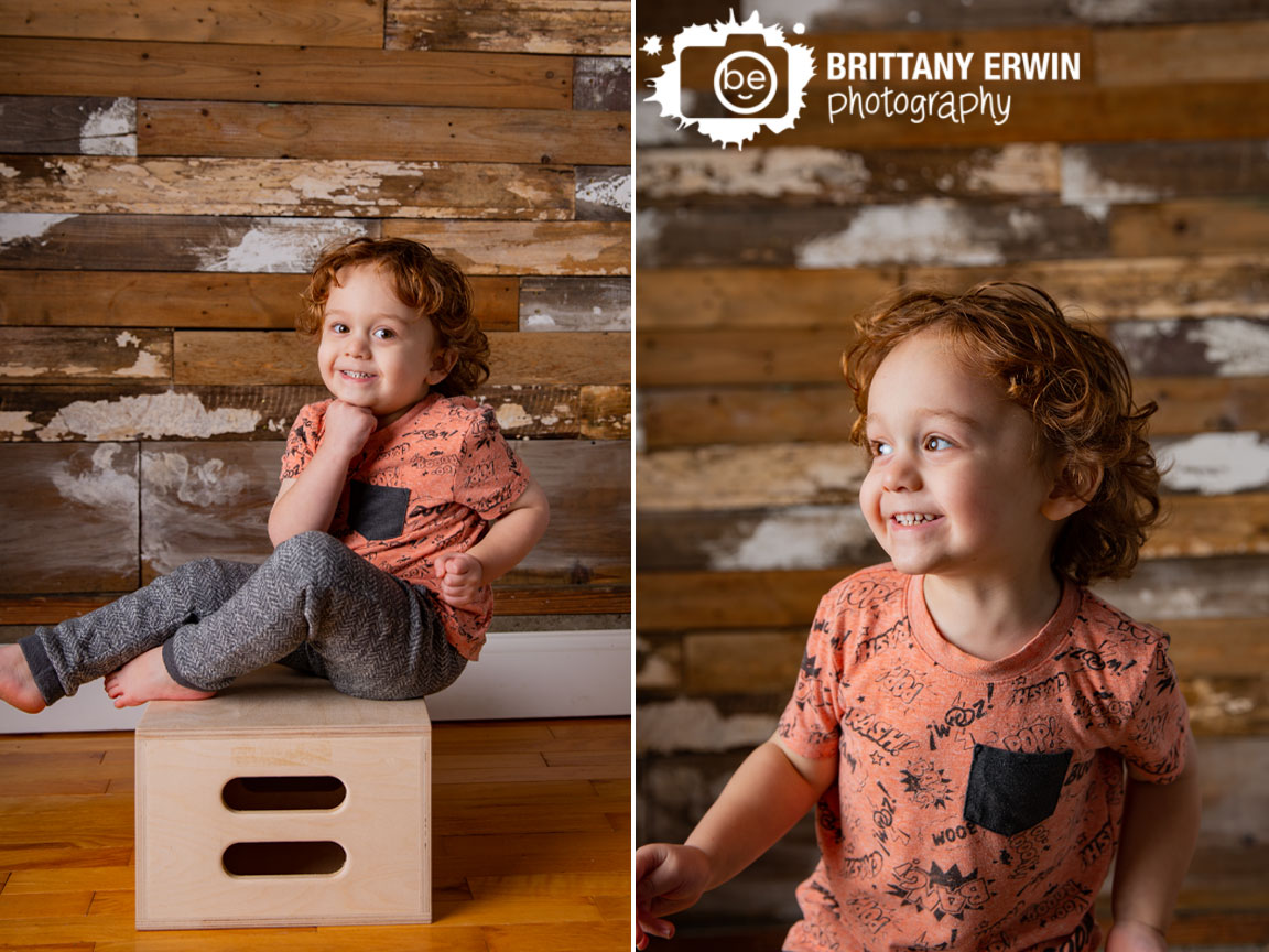 Indianapolis-rustic-wood-reclaimed-barn-background-studio-silly-laughing-toddler.jpg