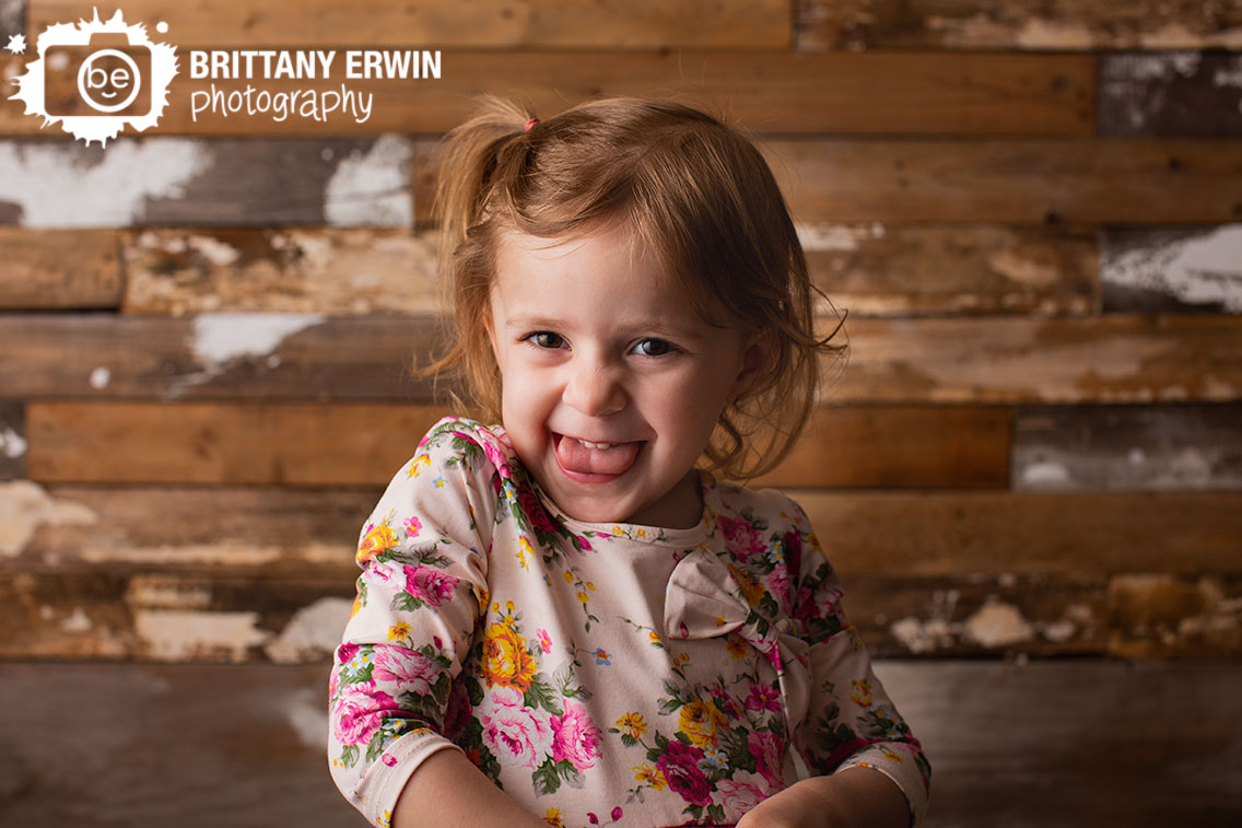 Indianapolis-portrait-studio-photography-silly-girl-sticking-out-tongue-spring-session.jpg