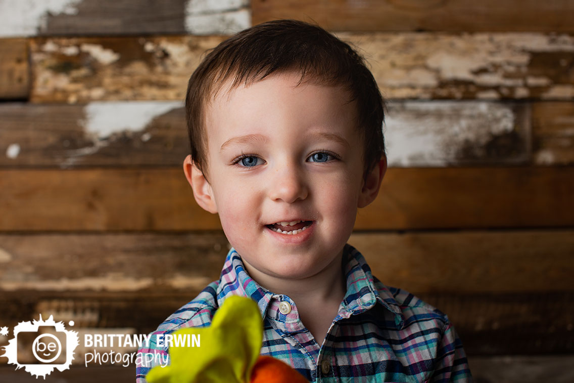 Indianapolis-portrait-studio-photographer-toddler-boy-with-carrot-spring-mini-session.jpg