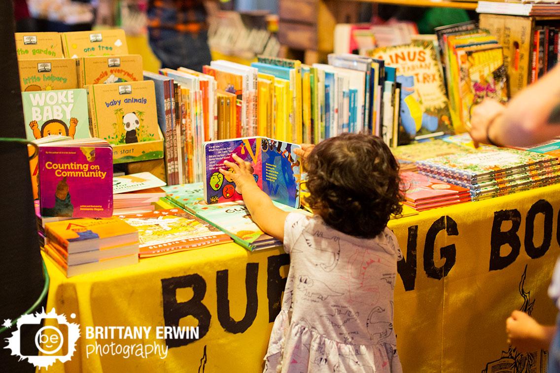 Burning-Books-display-table-Indy-VegFest-woke-baby-girl-reading-books.jpg