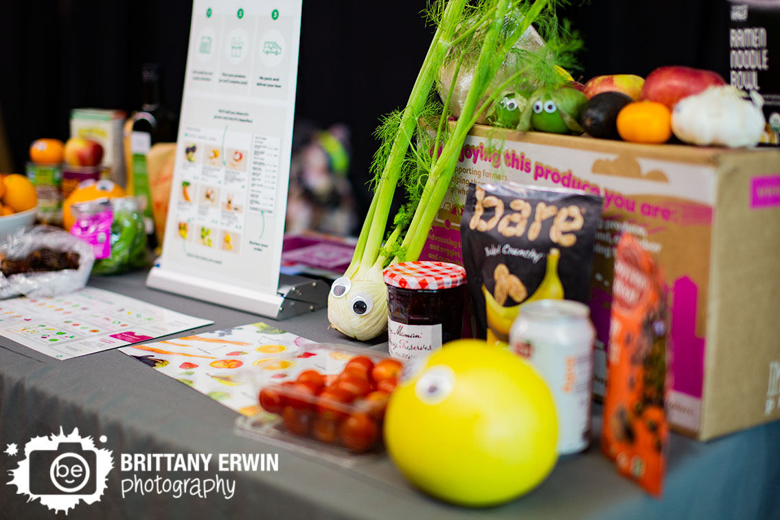 Indy-VegFest-booth-Imperfect-Produce-googly-eyes-on-vegetables-orange-preserves.jpg