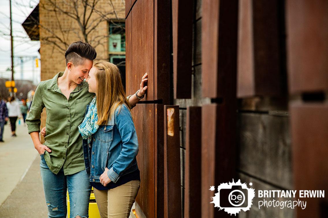 Mass-Ave-iron-sign-couple-engagement-portrait-photographer.jpg