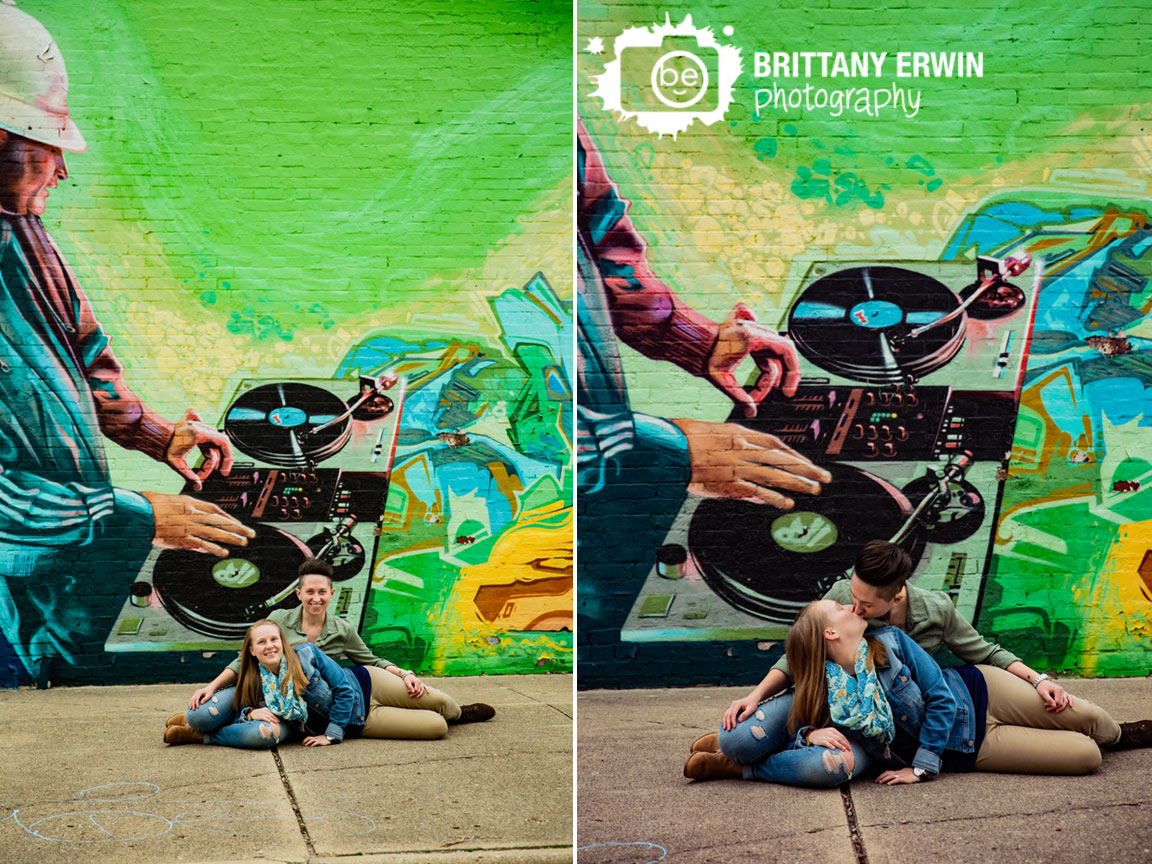 Mass-Ave-Indy-engagement-portrait-photographer-couple-on-sidewalk-with-mural-painting.jpg