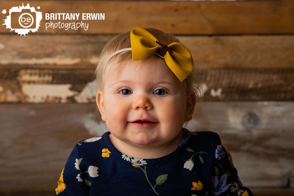 Indianapolis-studio-portrait-photographer-rustic-barn-wood-wall-baby-girl-yellow-bow-headband.jpg
