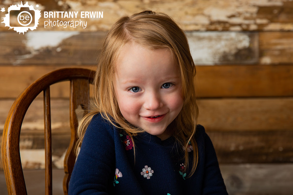 Indianapolis-studio-photographer-toddler-rocking-chair-antique-rustic-barn-wood-wall.jpg