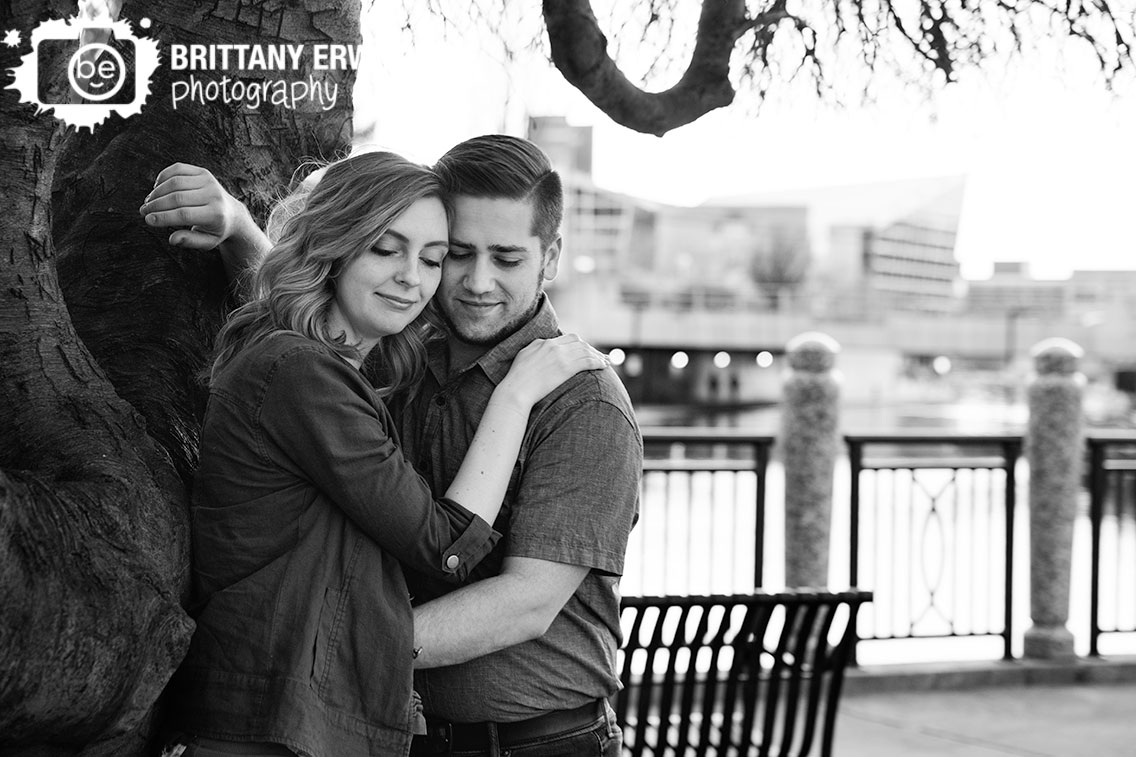Indianapolis-engagement-portrait-photographer-couple-lean-on-tree-at-the-canal.jpg