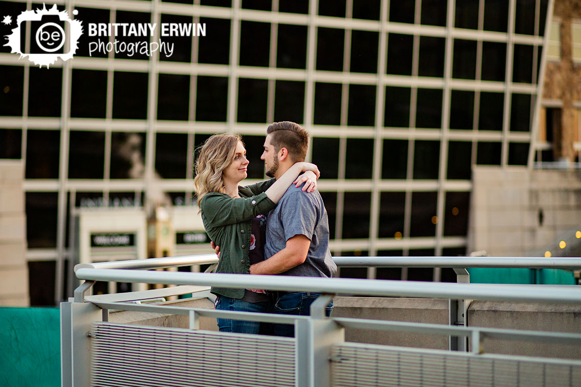 Indiana-State-museum-canal-side-engagement-photographer-couple-lean-on-rail.jpg