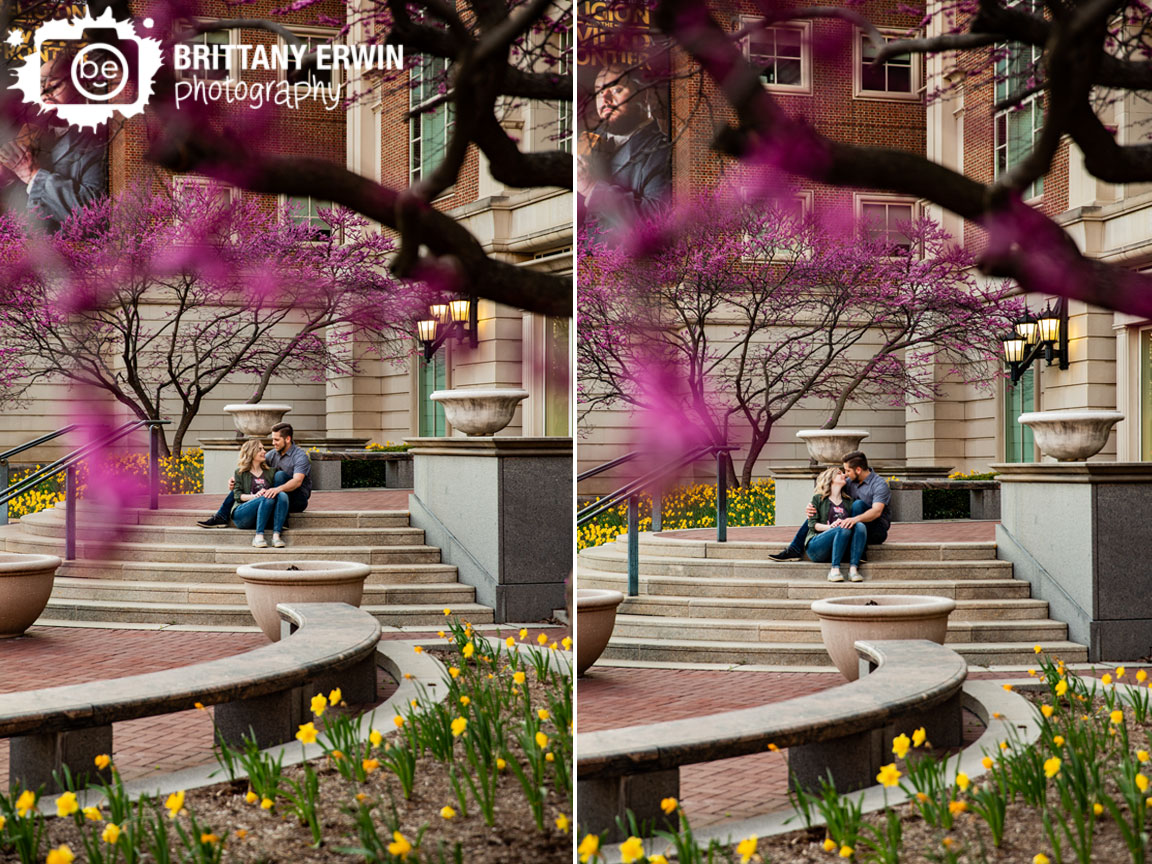 Indianapolis-engagement-portrait-photographer-couple-on-steps-of-indiana-historical-society-redbud-blooming-spring-trees.jpg