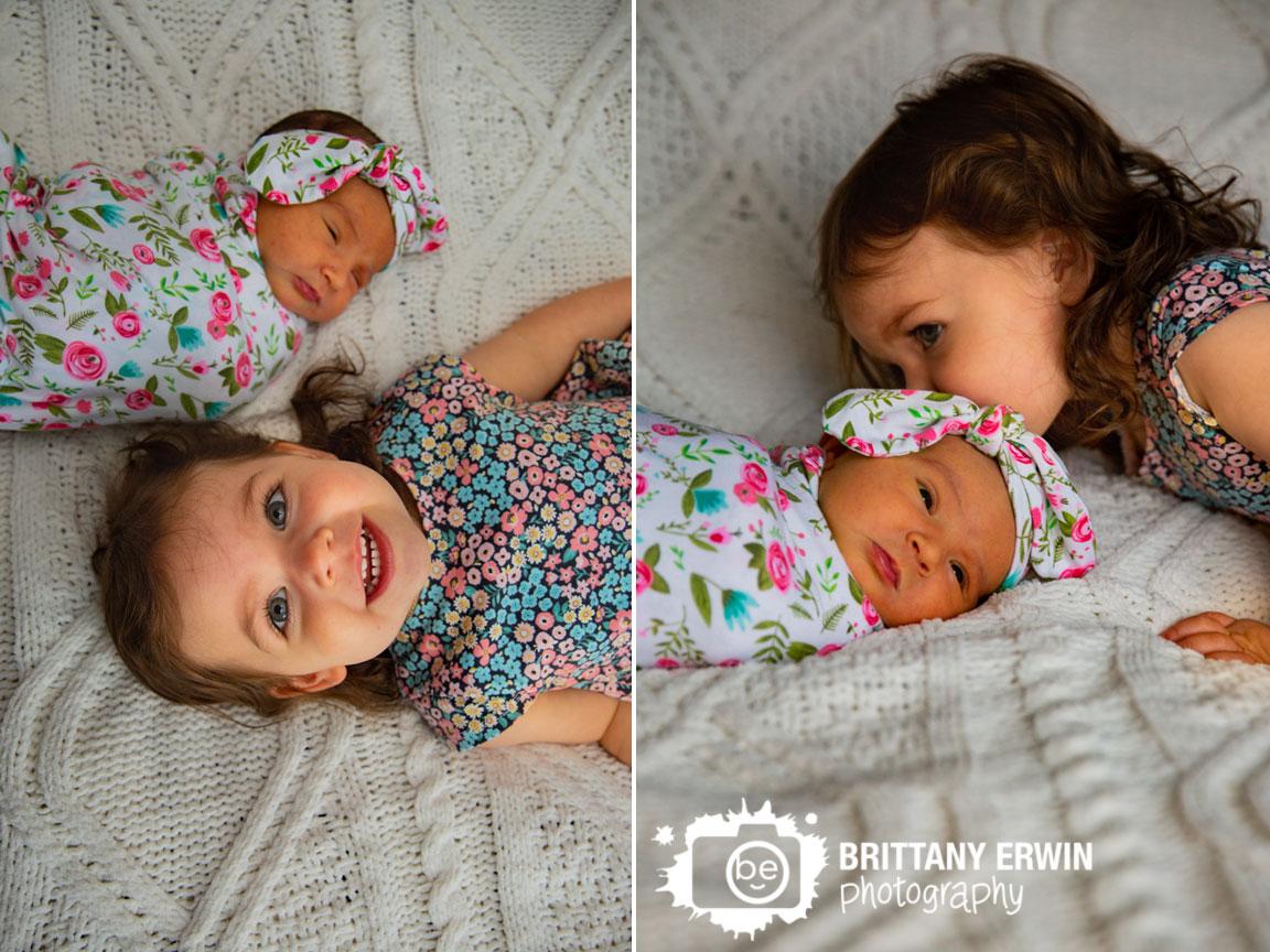 Indianapolis-portrait-photographer-big-sister-with-newborn-baby-girl-flower-dress-wrap.jpg