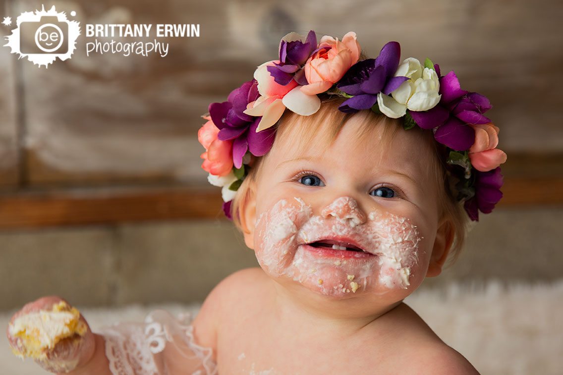 Indianapolis-portrait-photographer-cake-smash-icing-happy-girl-flower-crown-studio.jpg