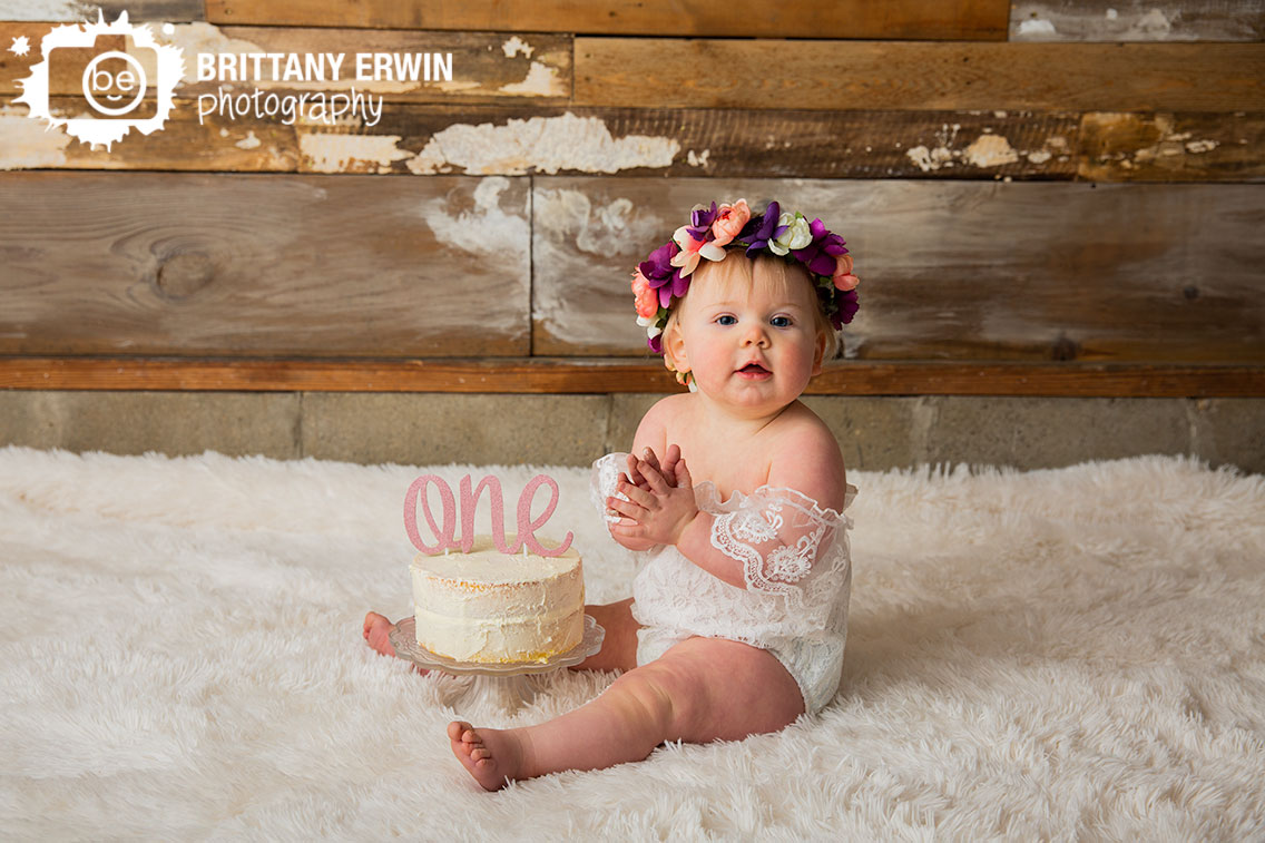 Indianapolis-portrait-studio-photographer-baby-girl-one-cake-topper-smash-floral-crown-white-romper.jpg