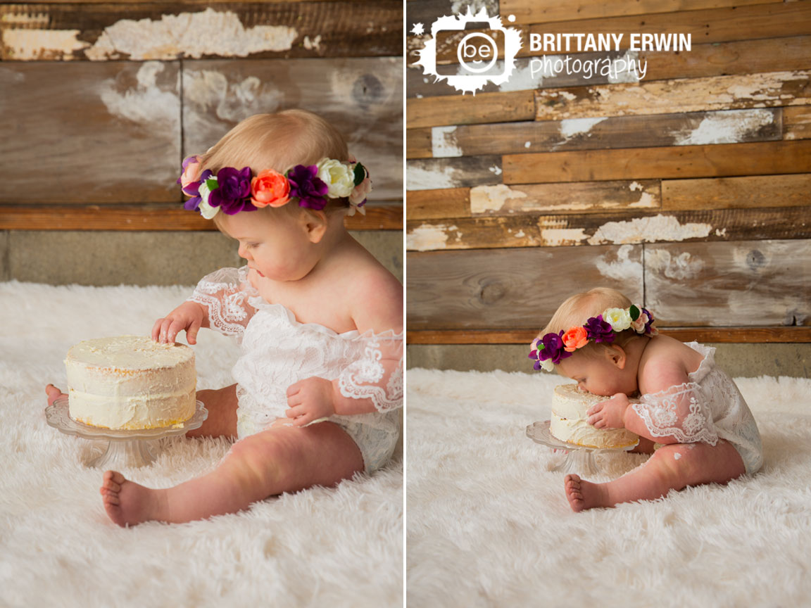 Indianapolis-portrait-studio-photographer-baby-girl-cake-smash-face-in-icing-white-lace-romper.jpg