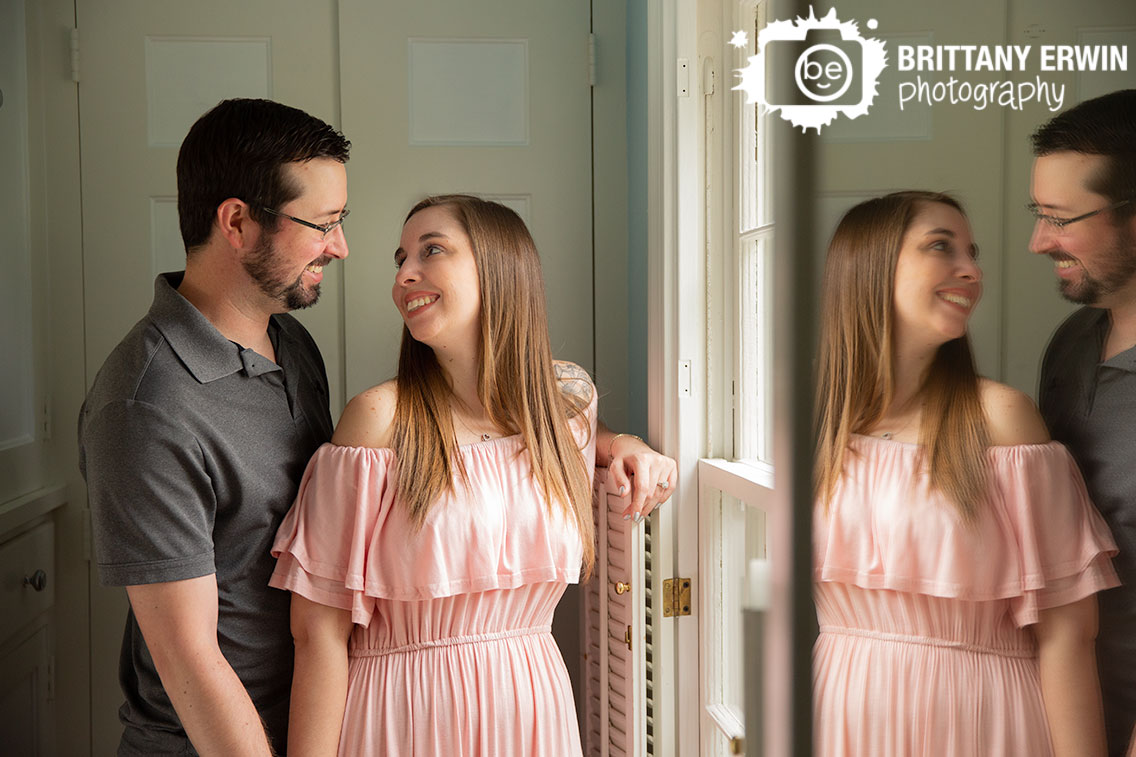 Danville-Indiana-engagement-portrait-photographer-couple-near-window-with-reflection.jpg