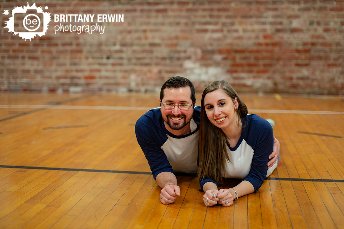 Danville-Indiana-engagement-portrait-photographer-brick-wall-couple-on-basketball-court.jpg