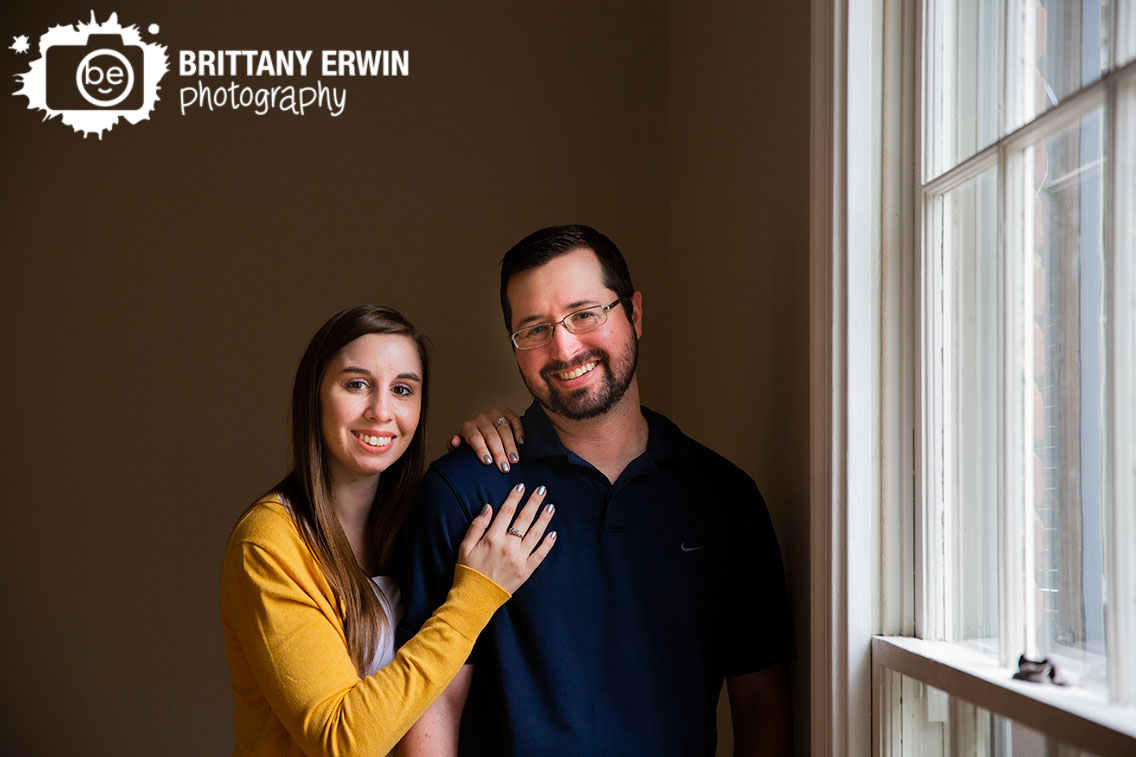 Engagement-portrait-photographer-couple-by-window-indoor-session.jpg