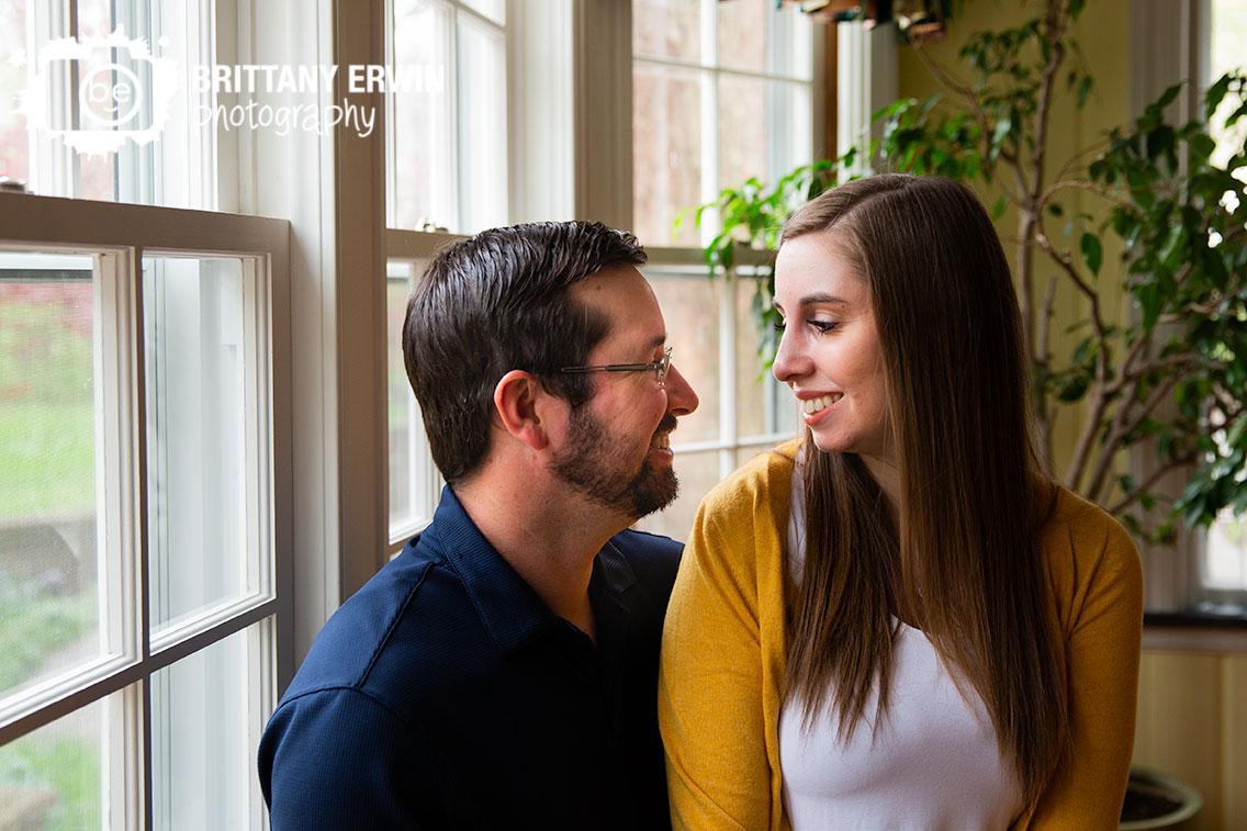Engagement-portrait-couple-in-window-seat-antique-historic-home-blanton-house-Danville.jpg