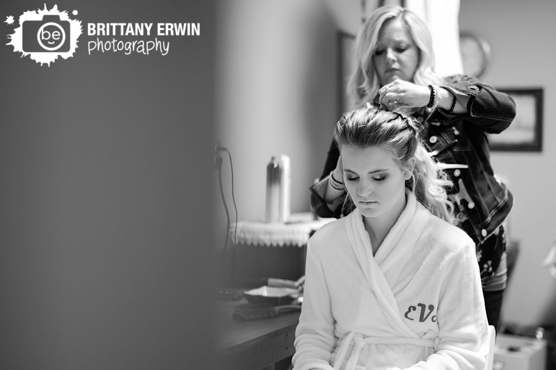 Indiana-wedding-photographer-hair-dresser-doing-brides-hair-with-bride-in-monogram-robe.jpg