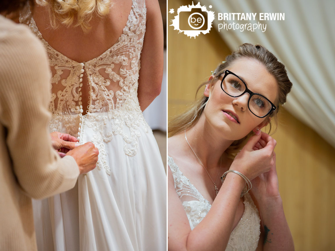 Indiana-wedding-photographer-photographs-bride-getting-ready-with-button-down-back-dress-and-earrings.jpg