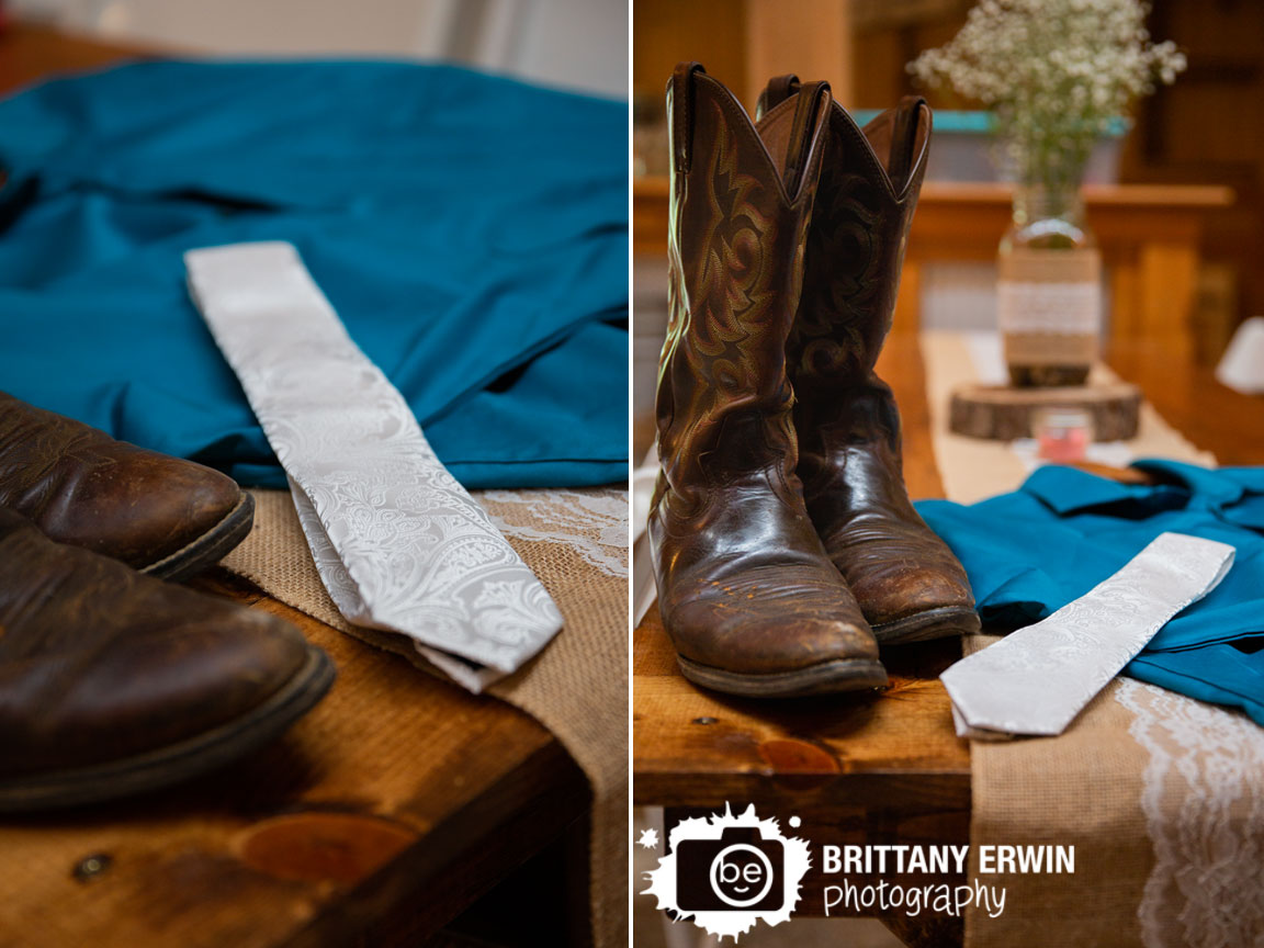 groom-details-on-table-with-brown-boots-blue-button-down-shirt-and-white-paisley-tie.jpg