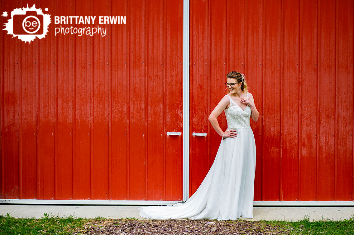 Bridal-portrait-red-barn-door-rustic-gatherings-wedding-venue.jpg