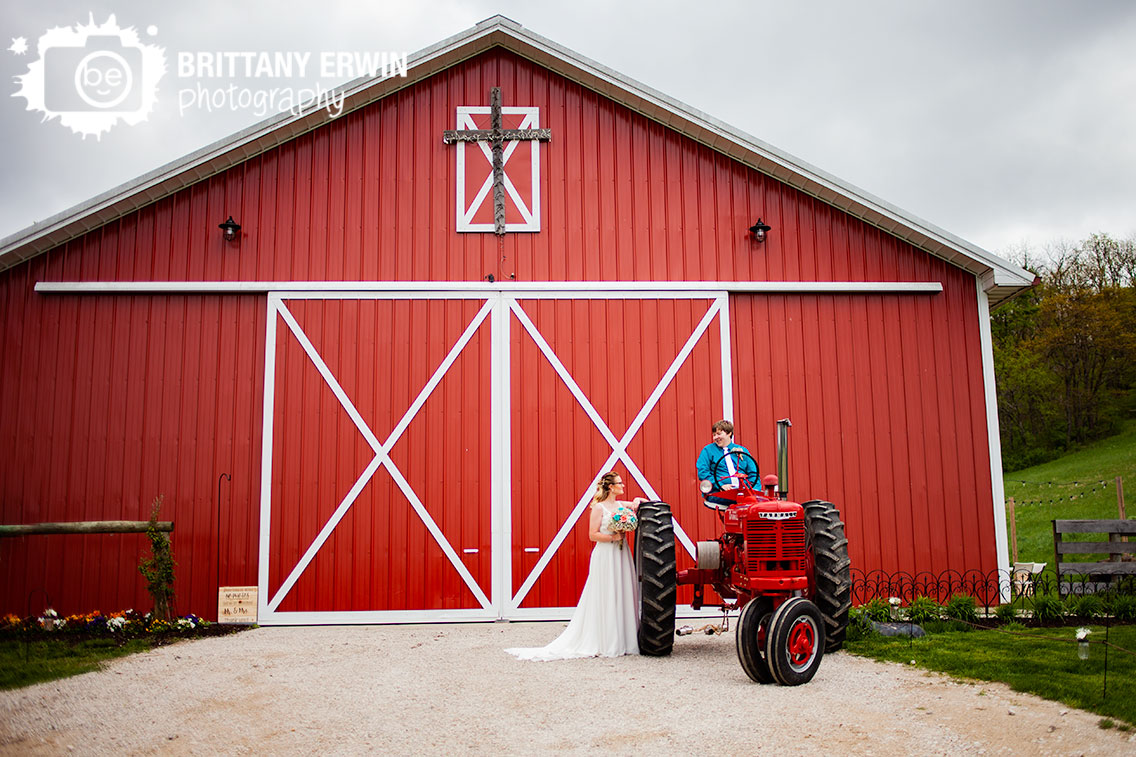 Indiana-wedding-photographer-Rustic-Gatherings-barn-couple-with-red-tractor-outside-spring.jpg