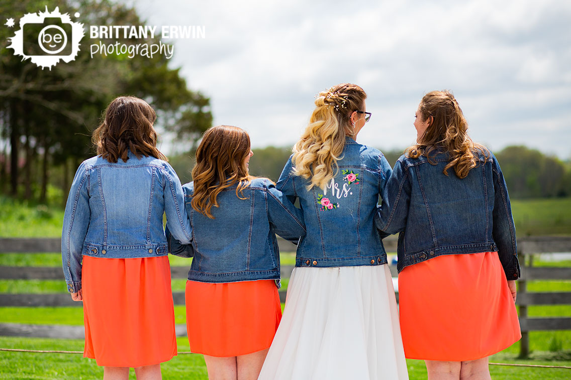 bride-with-bridesmaids-jean-jacket-group-Mrs-flower-on-back.jpg