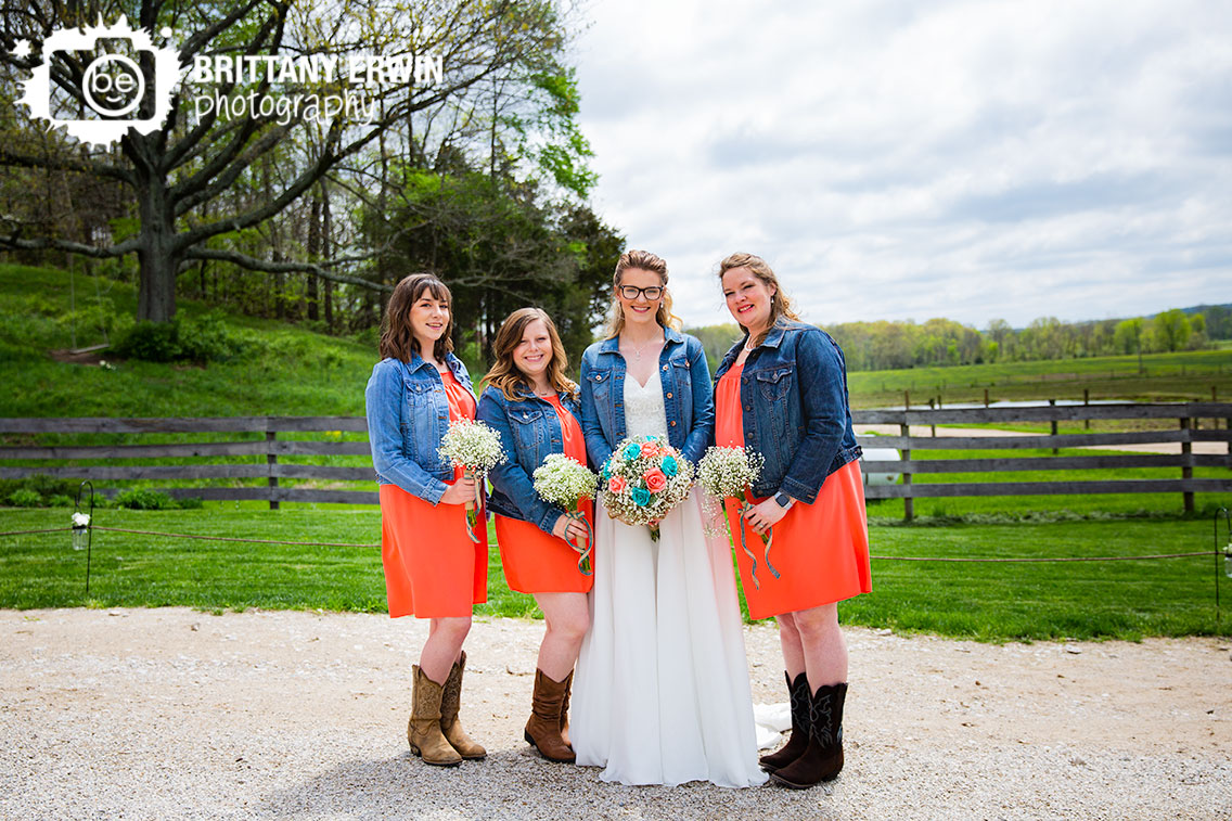 Bride-with-bridesmaid-portrait-group-outside-rustic-gatherings-pink-dress-jean-jacket.jpg