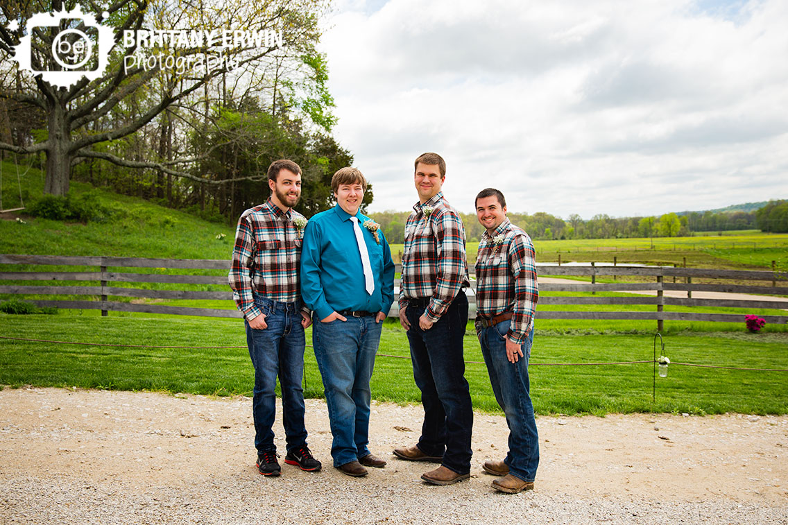 Groomsmen-portrait-with-groom-outside-rustic-gatherings-spring-wedding.jpg
