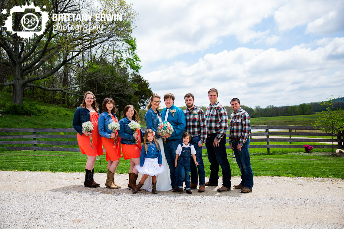 Wedding-bridal-party-group-portrait-outside-rustic-gatherings-barn-venue.jpg