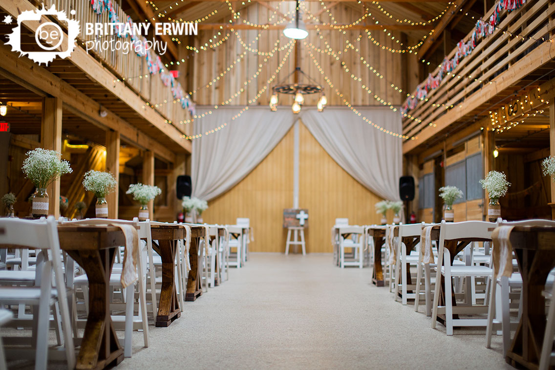 Rustic-Gatherings-wedding-barn-venue-indoor-ceremony-twinkle-lights-lanterns.jpg