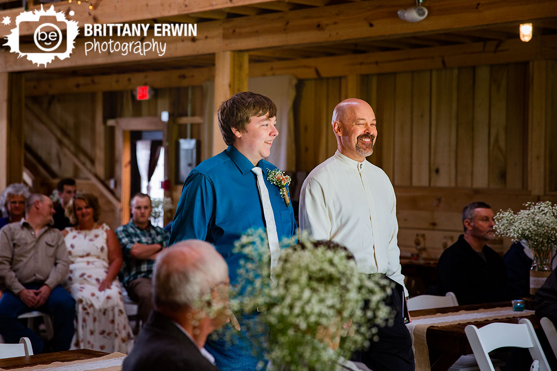 groom-walking-down-aisle-with-officiant-rustic-gatherings-llc.jpg