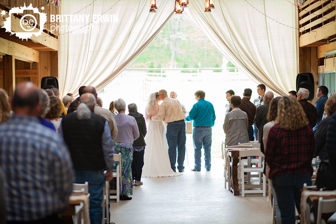 Indiana-barn-wedding-rustic-gatherings-ceremony-father-of-bride-cheek-kiss.jpg