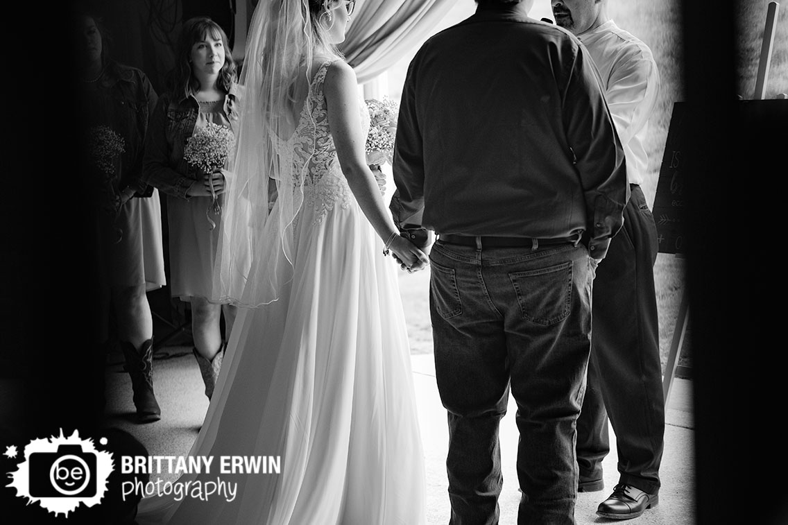 Indiana-wedding-photographer-bride-groom-holding-hands-ceremony.jpg