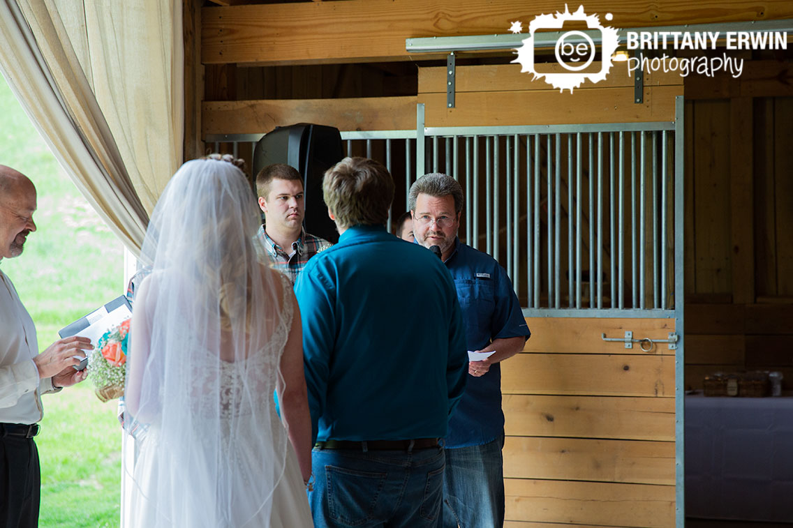 Indiana-wedding-photographer-reading-during-ceremony-rustic-gatherings-barn-venue.jpg