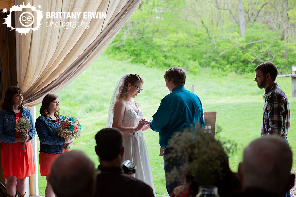 wedding-ring-exchange-ceremony-photographer-bride-groom-barn-door.jpg