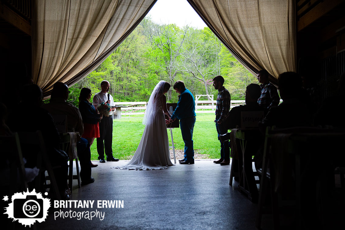 Indiana-wedding-photographer-unity-ceremony-silhouette-couple-braiding-cords.jpg