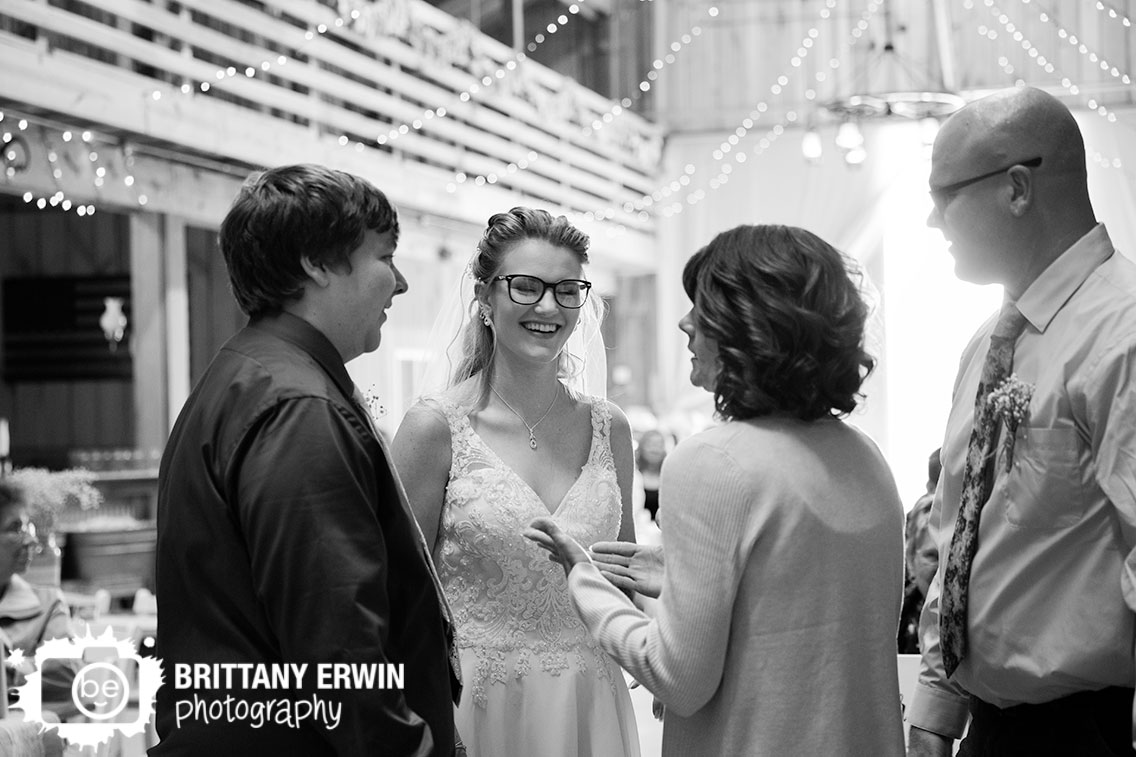 bride-and-groom-greet-mother-and-father-of-bride-wedding-reception.jpg