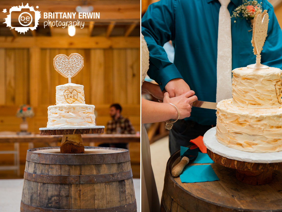 rustic-gatherings-wedding-barn-venue-wood-cake-heart-cutting-couple.jpg