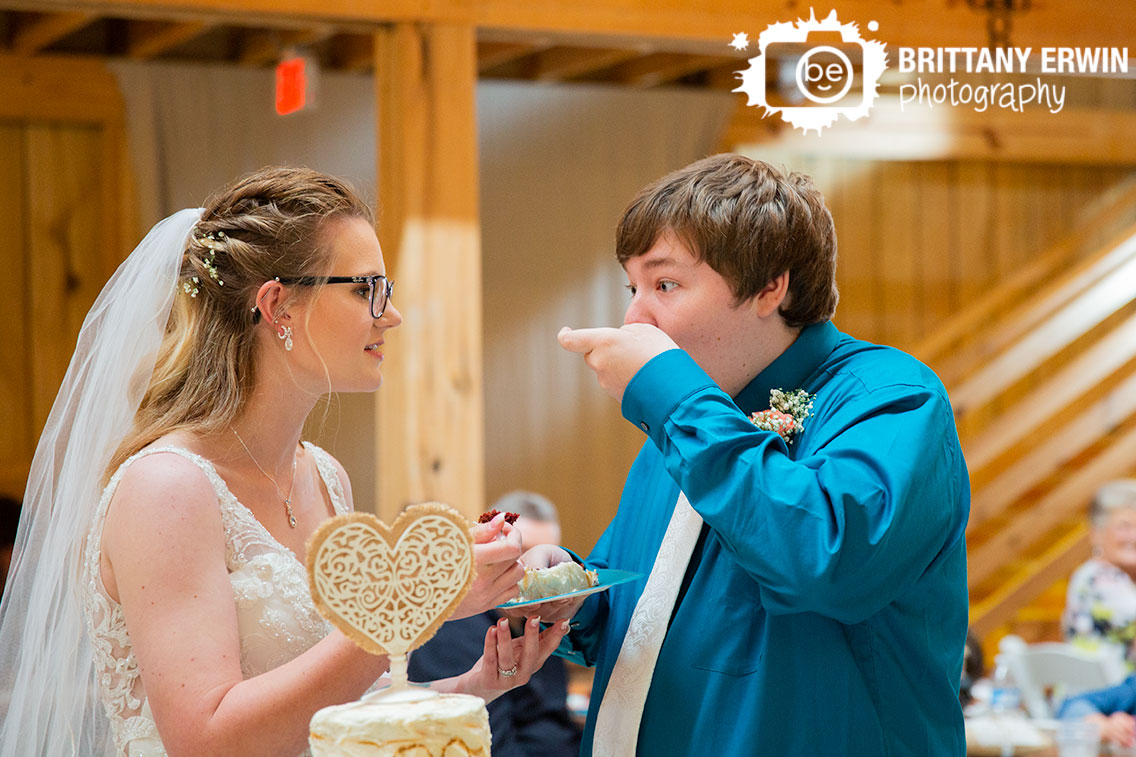 Wedding-photographer-rustic-gatherings-llc-cake-cutting-couple-groom-ate-first.jpg