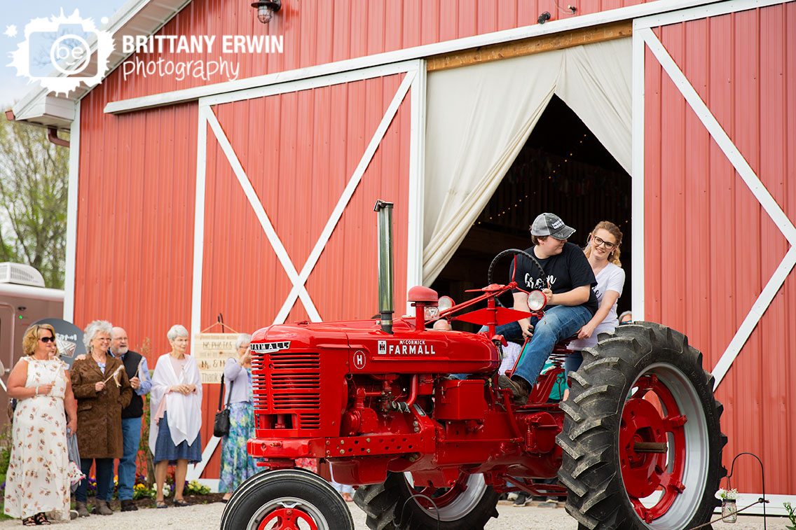 Indiana-wedding-photographer-couple-ride-farmall-tractor-getaway-exit.jpg
