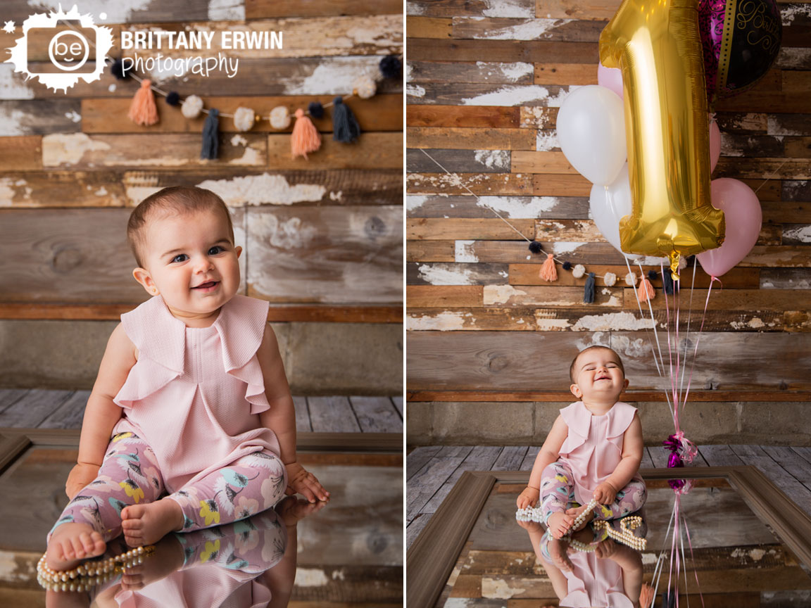 Rustic-studio-portrait-photographer-baby-girl-on-mirror-beads-balloons-barn-wood-wall.jpg