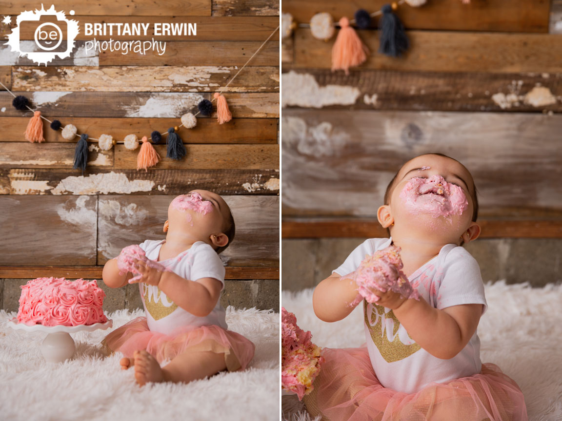 Indianapolis-portrait-photographer-first-birthday-cake-smash-girl-happy-icing-pink-face.jpg