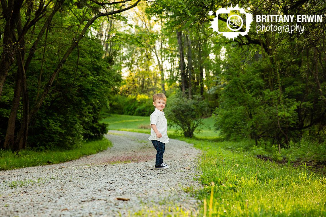 Indianapolis-portrait-photographer-outdoor-boy-walking-down-gravel-path.jpg