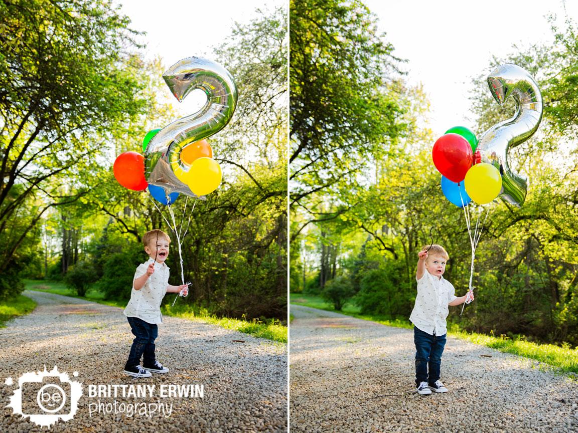 Indianapolis-portrait-photographer-toddler-boy-birthday-2-balloon-stick-casting-spell.jpg