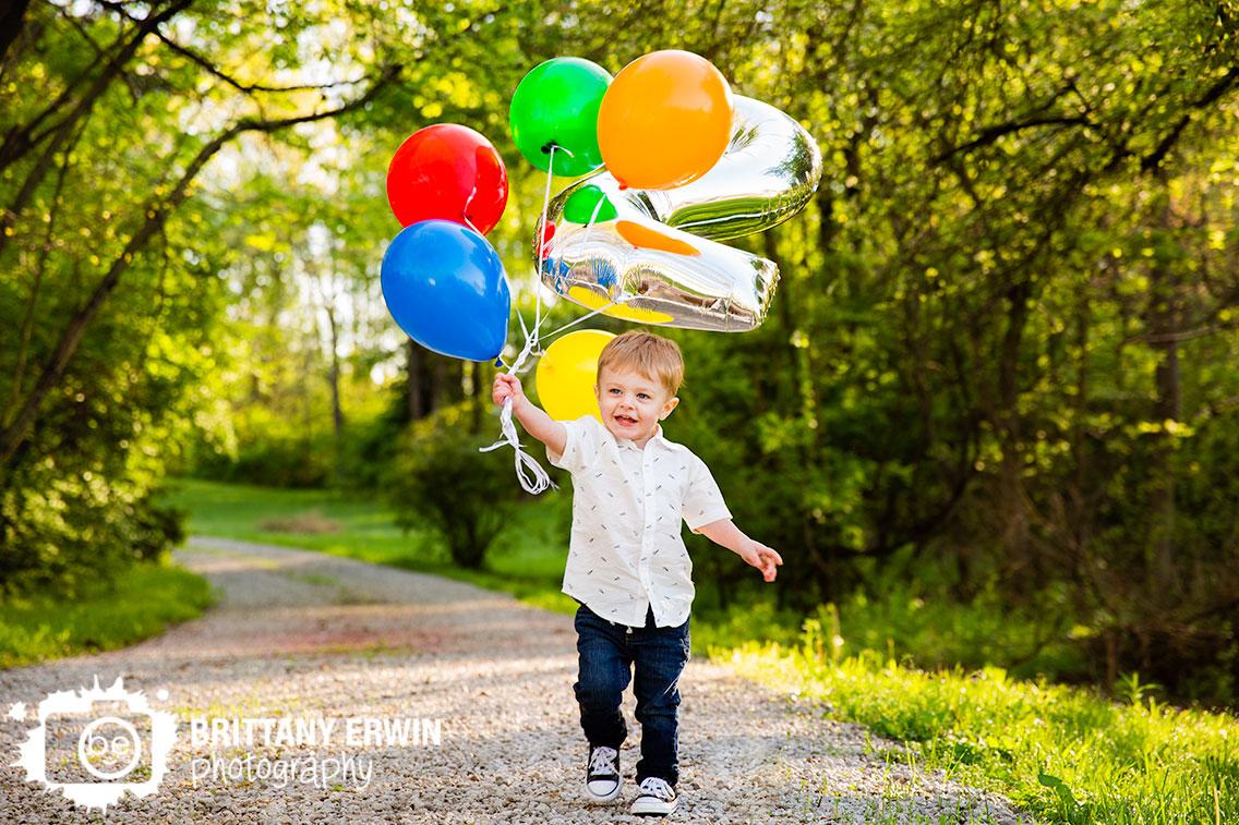 Indianapolis-portrait-photographer-birthday-balloon-boy-button-down-number-2-running.jpg