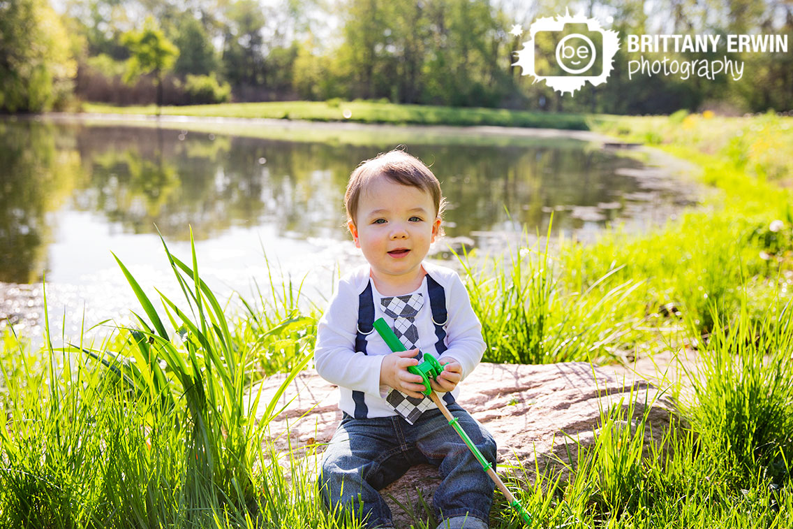 Spring-birthday-portrait-session-boy-fishing-by-pond-tie-suspenders.jpg