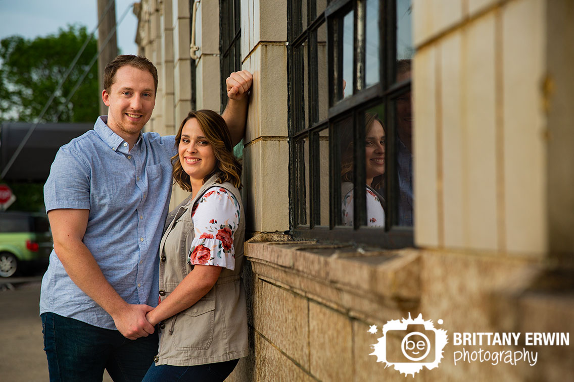 Fountain-Square-engagement-portrait-photographer-couple-stone-wall-spring-flower-shirt.jpg