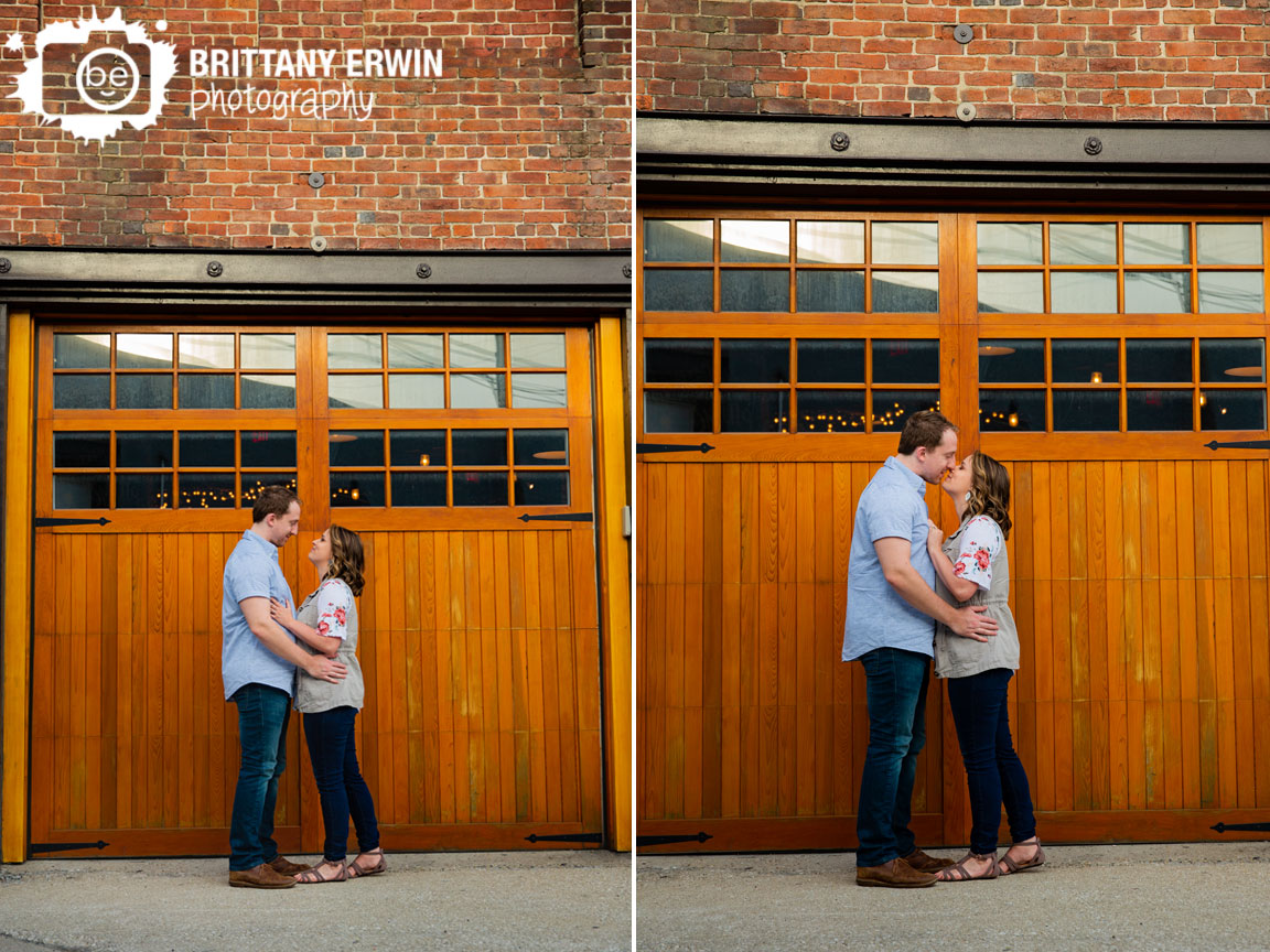 Indiana-engagement-portrtait-photographer-couple-kiss-in-front-of-Hotel-Tango-distillery-bar.jpg
