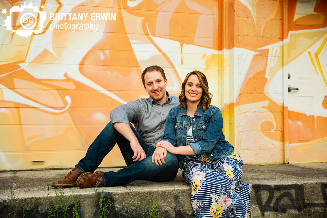 Fountain-Square-engagement-portrait-couple-with-grafiti-on-porch.jpg